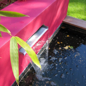 A modern Water feature set in the deck area.